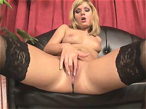 Pretty Victoria shine toying with a enormous crimson dildo