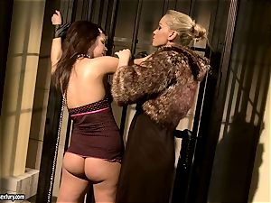 Kathia Nobili in hairy jacket torturing a steamy stunner