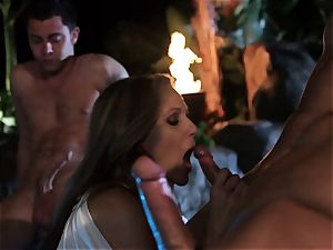 Julia Ann gargles a group of chisels in a pool