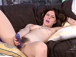 Rose Vermillion fumbles her hairy pussy with her magic wand