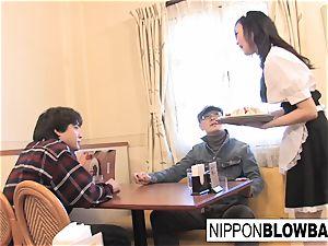 ultra-cute japanese waitress gives dual blowjob