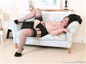 brown-haired in lingerie stretches nylon legs thumbs fuckbox