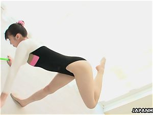 japanese gymnast playthings her gash and dances while stripping